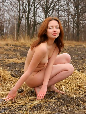 Sweet and sexy redheaded Galo showcases her slim fit body in the woods.