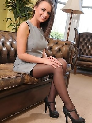 """Siobhan the sexy secretary looks great in black stockings"""